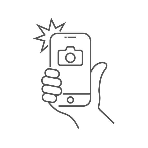 illustrazioni stock, clip art, cartoni animati e icone di tendenza di photo on smartphone with flash, hand is holding smartphone and doing photo. camera viewfinder, hand and flash. editable stroke. eps 10. - video call