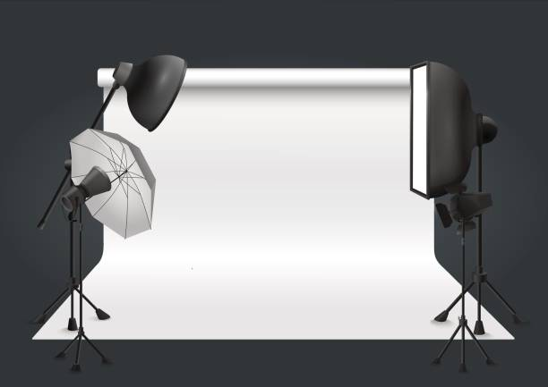 Bекторная иллюстрация Photo studio with lighting equipment and background. Vector illustration.