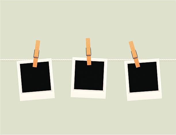 Photographs hanging on a line vector art illustration