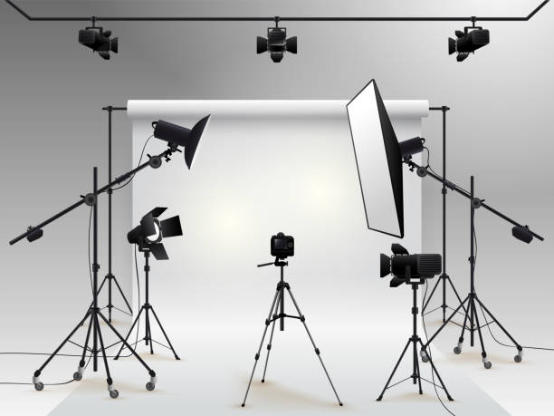 Photography studio vector. Photo studio white blank background with soft box light, camera, tripod and backdrop. Vector illustration. Isolated on white background Photography studio vector. Photo studio white blank background with soft box light, camera, tripod and backdrop. Vector illustration. Isolated on white background studio stock illustrations
