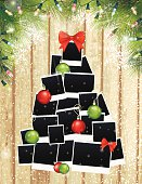 Photos Christmas Tree and Evergreens On Wood Background