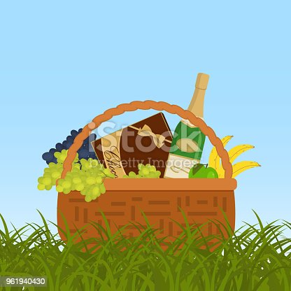 Picnic basket in a green grass. Wicker basket with champagne and food. There is a bottle of sparkling wine, a box of chocolates, bananas, an apple, grapes in the picture. Vector illustration