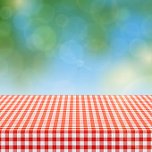 Picnic table with red checkered pattern of linen tablecloth and blurred nature background vector illustration. Checkered tablecloth textile for garden table