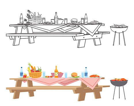 Picnic wood table with fast food and drink