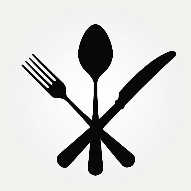 A picture of a black spoon for and knife Black cutlery setting isolated on white background. EPS version 10 with transparency included in download. cooking clipart stock illustrations