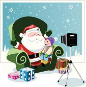 happy child sitting on Santa's knee in front of camera