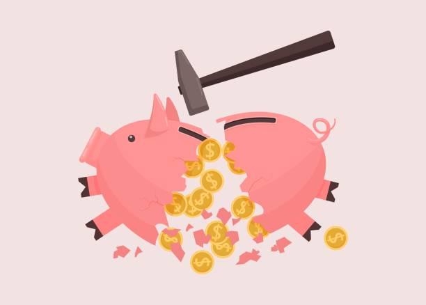 Piggy bank broken by hammer. Broken pink piggy bank spillover savings cash.