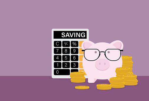 Piggy bank wears eyeglasses with a stack of coins and a calculator