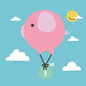 Piggy coin bank and money bag flying on sky