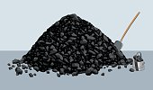Pile of coal with shovel and bucket