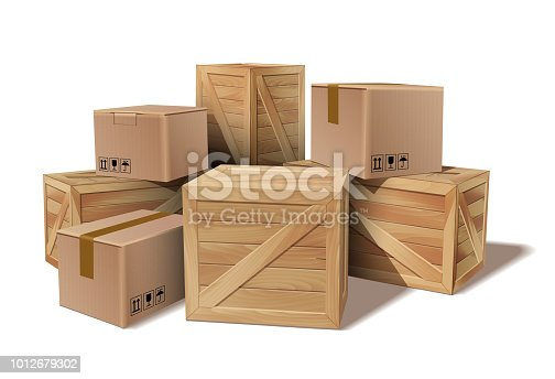 istock Pile of stacked goods cardboard and wooden boxes. 1012679302