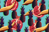 Exotic tropical fruit pattern with pineapples and pomegranates on blue background