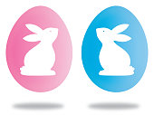 Vector illustration of pink and blue easter bunny eggs with shadows.