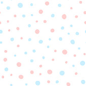 Pink and blue round spots on white background. Cute seamless pattern. Irregular polka dots. Drawn by hand. Coloured vector illustration.