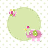 illustration of pink patterned baby elephant and flower on green round label and polka dot background