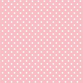 Pink background with white polka dots arranged neatly