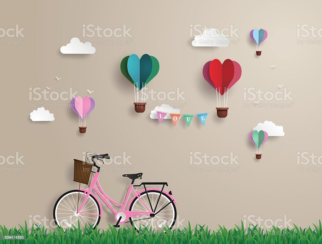 Pink bikes parked on the grass vector art illustration