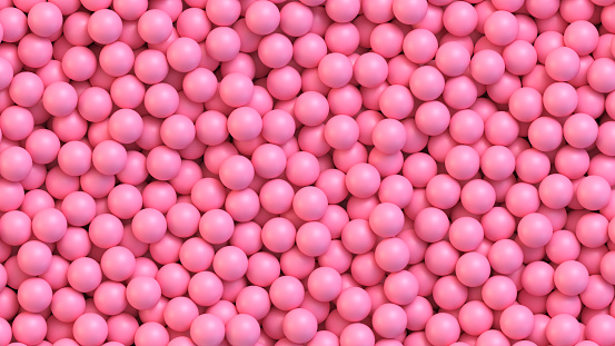 Pink candy balls. Pile of pink balls, sugar coated candy