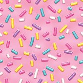 Seamless pattern of pink donut glaze with many colorful decorative sprinkles