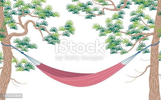 istock Pink hammock hanging between two old pines 1310332606