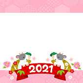 Pink frame composed of various Japanese patterns, illustration of cows with 2021 ribbon, icons of cherry blossoms, plum blossoms and peony flowers for the New Year of the Ox in Japan