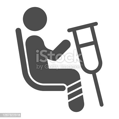 istock Place for disabled people solid icon, Public transport concept, Priority seating sign on white background, person in chair with crutches icon in glyph style. Vector graphics. 1257322318