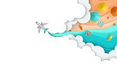 The plane flies through the clouds, below you can see the beach, sea, sand, umbrellas. Layered vector illustrations in the style of paper cutting for advertising. Banner, landing page, place for text