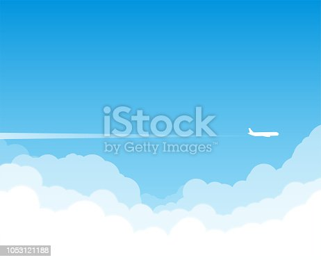 istock Plane flying above clouds 1053121188