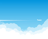 Airplane flying above clouds. Jet plane with exhaust white trail. Blue gradient and white plane silhouette. White and transparent clouds on the blue sky.
