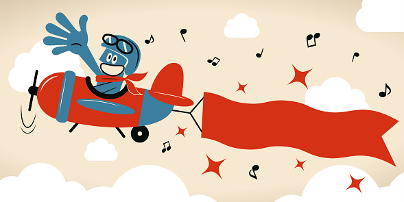 Plane pilot with aviator's cap and glasses flying on airplane with banner (poster)