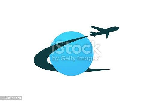 istock Plane travel icon. Air travel around the world. Flying around the world. Travel agency logo. Vector illustration. 1258141375
