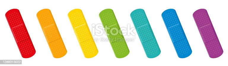 istock Plaster set. Colorful collection with seven different colors - red, orange, yellow, green, cyan, blue and purple adhesive plasters. Isolated vector illustration on white background. 1288313022