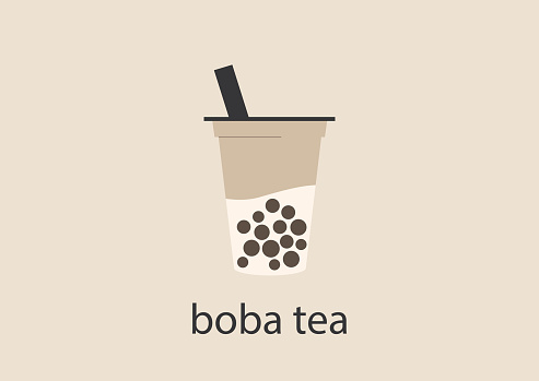 A plastic cup of boba tea with tapioca pearls and milk, a trendy asian drink