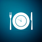 Plate with clock, fork and knife icon isolated on blue background. Lunch time. Eating, nutrition regime, meal time and diet concept. Flat design. Vector Illustration