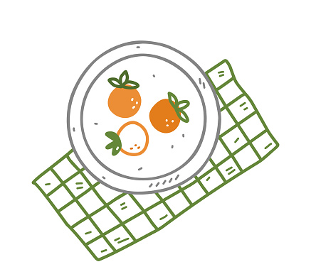 Plate with persimmon on a green checkered tablecloth in doodle style