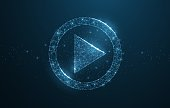 Polygonal wireframe play icon looks like constellation on dark blue night sky with dots and stars. Video, movie, player or other concept illustration or background