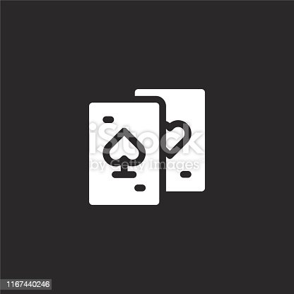 istock playing cards icon. Filled playing cards icon for website design and mobile, app development. playing cards icon from filled arcade collection isolated on black background. 1167440246