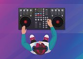 DJ playing vinyl on the neon color light background. Top view. DJ Interface workspace mixer console turntables. Night club concept. DJ young man