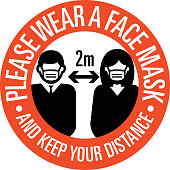 Please wear a face mask and keep you distance sign protecting society. Social distancing from each other during Coronavirus infection pandemic