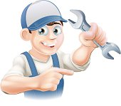 A plumber, mechanic or engineer in overalls pointing and holding a spanner or wrench. Vector file is eps 10 and uses transparency blends and gradient mesh