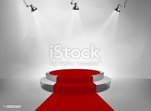 lighted studio room with podium and red carpet