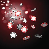 Poker chips floating in the air on a red and black background