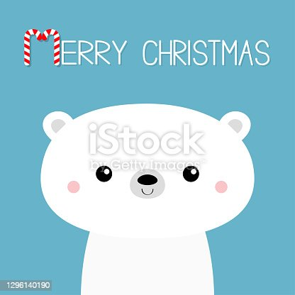 istock Polar white bear cub face. Merry Christmas. Candycane text. Happy New Year. Cute cartoon baby character. Arctic animal. Hello winter. Flat design. Greeting card print. Blue background. 1296140190