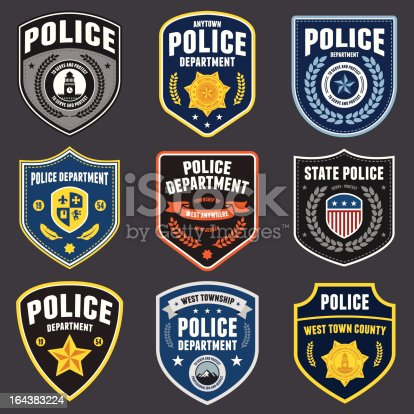 Set of police law enforcement badges and patches.