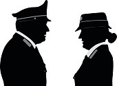 Silhouette illustration of the profile a a female and a male police officers in Italy.
