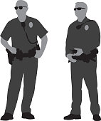 Vector silhouettes of two policemen standing next to each other.