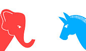 istock Political Elephant and Donkey. Republican and democrat voter concept. Set of United States Political Party Symbols. Vector illustration of a blue donkey and a red elephant 1220751327