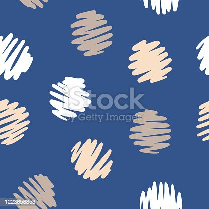 Polka dot seamless pattern. Decorative hand drawn circles isolated on blue. Simple graphic background.