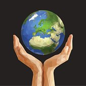 polygonal cupped hands that hold polygon planet earth europe gra