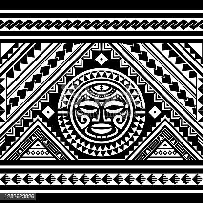 istock Polynesian seamless geometric vector pattern with Maori face mandala tattoo design, Hawaiian tribal ornament in white on black background 1282623826